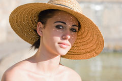 Summer brunette in straw hat. Royalty Free Stock Photo