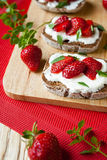 Summer Bruschetta with strawberries for breakfast Stock Image