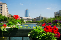 Summer in Bucharest. View of old and new Bucharest from the bank of Dambovita River during a sunny summer day Royalty Free Stock Photo