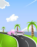 Summer cabrio ride. Pink cabrio car on the coastline road. Ocean scenery and cloudy sky with flying airplane in the corner Royalty Free Stock Image