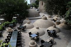 Summer cafe on the roof of old baths hammam in the old town of Icheri Sheher royalty free stock image
