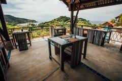 Summer cafe on veranda with vintage wooden furniture on background sea Stock Images