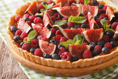 Summer cake with fresh figs, raspberries and blueberries close-u Stock Photo