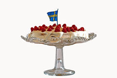 The Summer Cake. A typical summer cake or gateau in Sweden with fresh raspberry, double cream on a sponge-cake royalty free stock photography