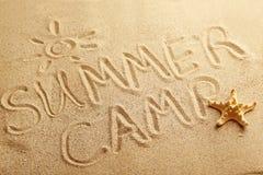 Summer camp. Handwritten in a beach sand Stock Photos