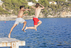 Summer camp kids. Jumping in sea Royalty Free Stock Photos