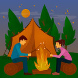 Summer Camp. Man and Woman sitting by Fireplace Royalty Free Stock Photography