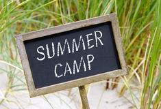 Summer camp on sign Stock Photos
