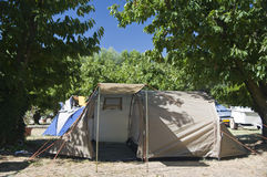 Summer camp site tent. A four person tent put up in a summer camp site Royalty Free Stock Photo