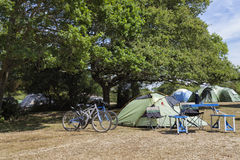 Summer camping in a forest, with bikes outside Royalty Free Stock Photos