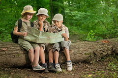 Summer camps,scout children camping and read map in forest Stock Images