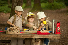 Summer camps,scout children read map Royalty Free Stock Images