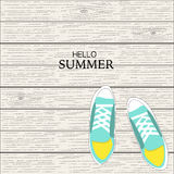 Summer canvas shoes with wood linear background Royalty Free Stock Images