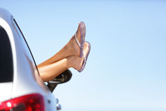 Summer car road trip vacation fun woman feet out Stock Photos