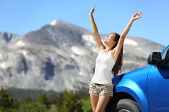Summer car travel freedom woman in Yosemite Park. Summer car travel freedom woman in Yosemite National Park with arms raised up cheerful and happy. Summer road Stock Photos