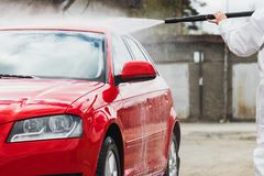 Summer Car Washing. Cleaning Car Using High Pressure Water.  stock photos