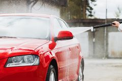 Summer Car Washing. Cleaning Car Using High Pressure Water.  royalty free stock photography