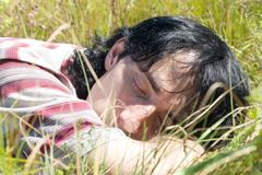 Summer Carefree. Sleeping In The Grass Stock Image