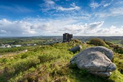 Summer at Carn Brea. Carn Brea Castle, a former hunting lodge perched high above the town of redruth in Cornwall Royalty Free Stock Image