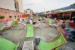 Summer chaise lounge and cheap furniture in outdoor cafe Royalty Free Stock Images