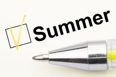 Summer - checkbox with a tick on white paper with pen. Checklist concept stock illustration