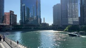 Summer in Chicago where people take advantage of the Chicago River with boats and the riverwalk