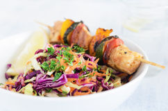 Summer chicken skewers with coleslaw Stock Photo