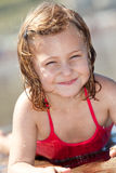 Summer child. Portrait of a smiling little girl on the beach Stock Photo