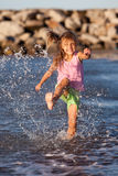 Summer child. Happy girl having fun by the ocean Stock Images