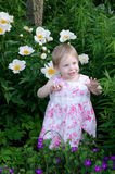 toddler in pink in a garden Stock Photos