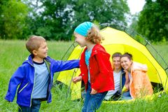 Summer child camping in tent Royalty Free Stock Photos