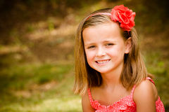 Summer child portrait of smiling pretty young girl. Outdoors Royalty Free Stock Image