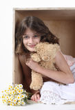 Summer child's games. Little girl play in hide-and-seek with bear royalty free stock image