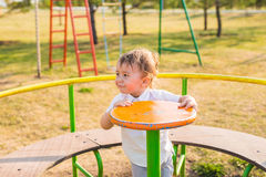 Summer, childhood, leisure and child concept - happy boy on children playground Royalty Free Stock Photos