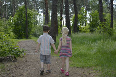 In summer, children go to the forest on a footpath. Royalty Free Stock Photos