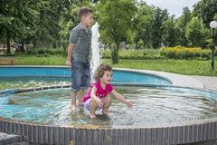 In the summer, children play in the fountain in the park. Royalty Free Stock Photos