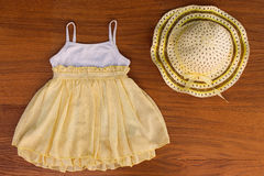 Summer children's clothing: dress and hat Royalty Free Stock Image