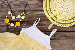 Summer children's clothing: dress, hat and beads Stock Photo