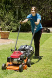 Summer Chores - Lawn Mowing. As the summer rains start the regular chores of tending to the lawn are a regular weekend activity Stock Photos