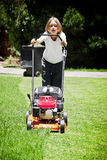 Summer Chores - Mowing Lawn. As the summer rains start, so to do the regular chores of mowing the lawn, etc Royalty Free Stock Images