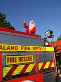 Summer Christmas: santa on fire truck Royalty Free Stock Images