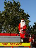 Summer Christmas: santa parade. Christmas parade santa about to throw lollies (candy) to kids from top of fire truck in Northland, New Zealand stock image