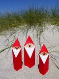 Summer Christmas: santas in sand stock photo
