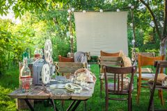 Summer cinema with old analog films in the garden. Session in outside Royalty Free Stock Photos