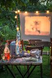 Summer cinema with retro projector in the evening in garden Stock Photo