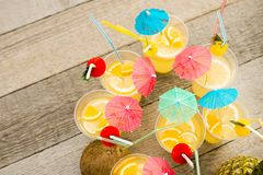 Summer citrus cocktail with umbrellas. Refreshing lemonade. stock images