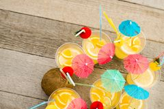 Summer citrus cocktail with umbrellas. Refreshing lemonade. stock photo