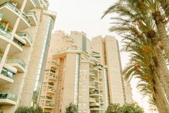 Summer city buildings and exotic palm trees. Tourism in Israel. Ancient city, daylight Stock Photo