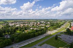 Aerial photography. Small city landscape, amazing clouds. Summer city landscape. Aerial photography Royalty Free Stock Photography