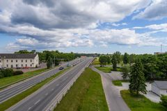 Aerial photography. Small city landscape, amazing clouds. Summer city landscape. Aerial photography Stock Photography